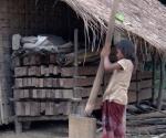 A girl husking rice
