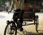 A smiling rickshaw wallah