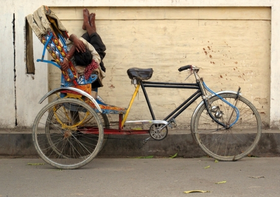 A napping rickshaw wallah