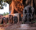 Idols beneath a tree near Gokarna's bathing tank