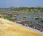 Washing in the Tungabhadra River after Holi