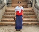 Claire in a sarong provided for modesty at Wat Haw Phra Kaew