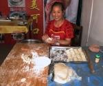 Mrs Fan making dumplings at Sanjiang