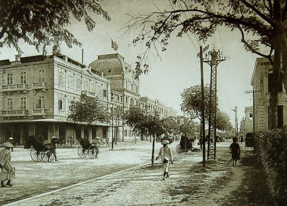 A black and white photo of the Hotel Metropole in Hanoi