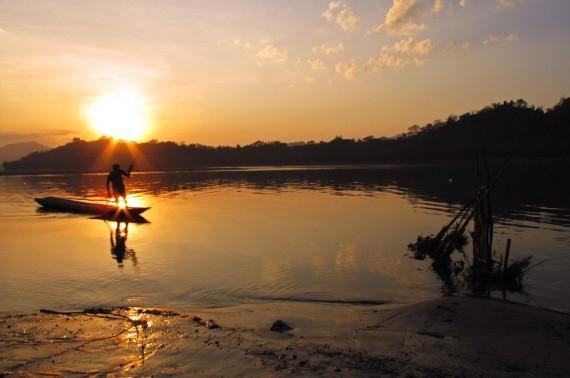 The Mekong reflects dusk's eerie light