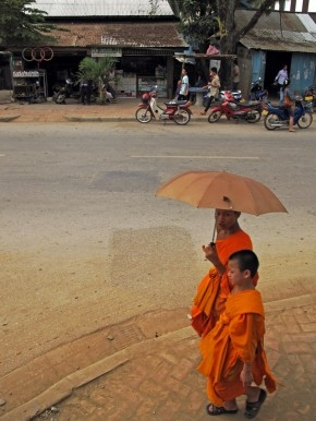 Monks walk down the road out of Luang Prabang