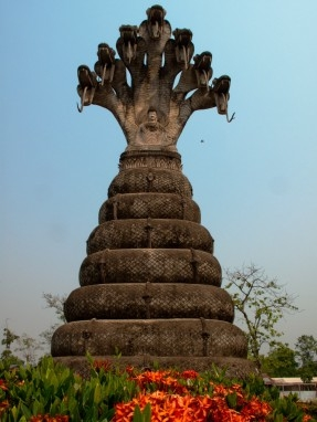 Buddha seated beneath the Naga: The largest statue at Salakaewkoo Sculpture Park