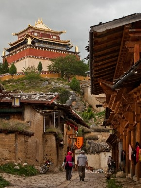 An old town street in Shangri-La, with the temple overhead