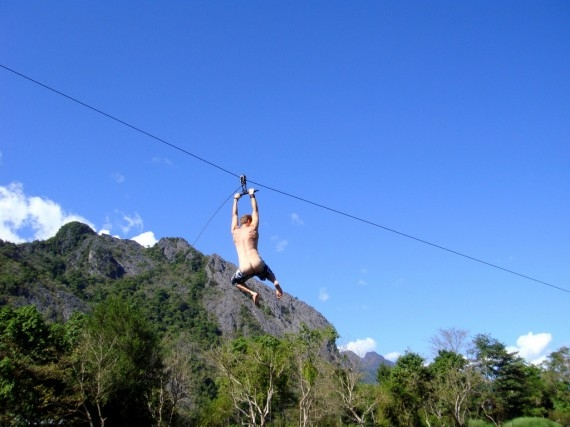 Bare bummed on a rope swing in Vang Vieng, Laos