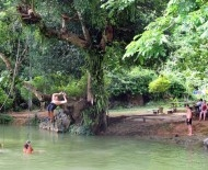 Swings over the 'Blue Lagoon' in Vang Vieng, Laos
