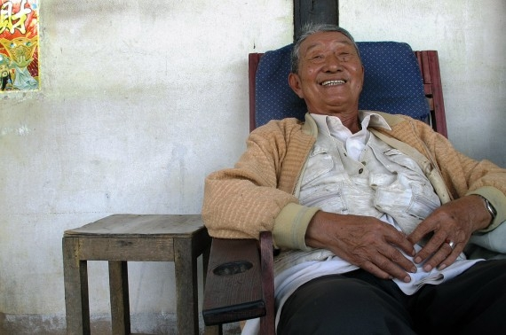 Zhan Dening outside his family home in Mae Salong